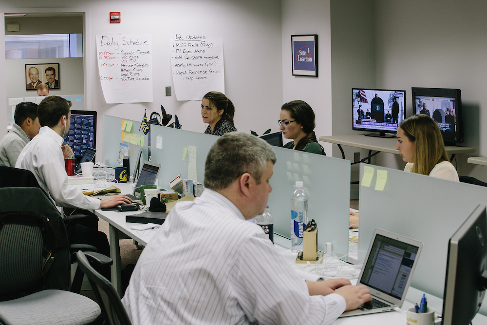 Julia Cotrone, center top, and other analysts work in the War Room of America Rising, a conservative political action committee out of Rosslyn, Va. that was started in April by Republican operatives Tim Miller, Joe Pounder and Matt Rhoades. America Rising BLUE